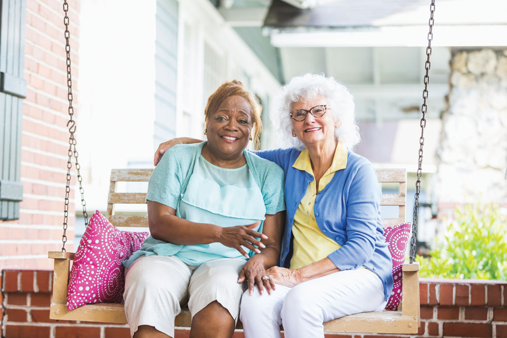 Two Independent Living Residents Rocking on a Porch Swing