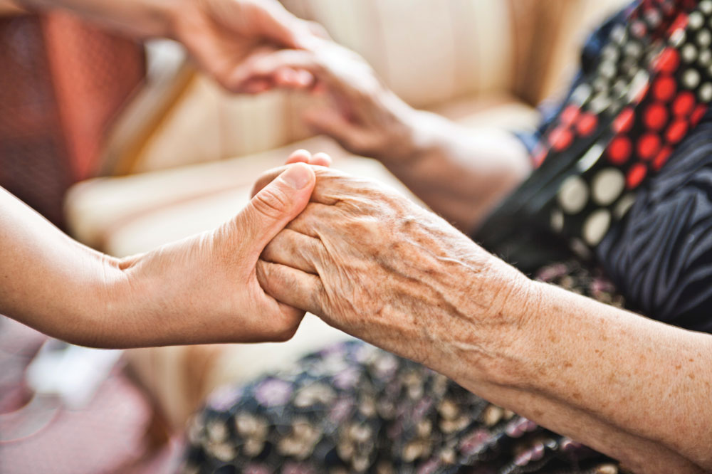 Charter Senior Living of Northpark Place Residents Holding Hands