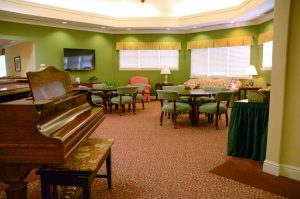 Charter Senior Living Northpark Place Common Area baby grand piano and chairs